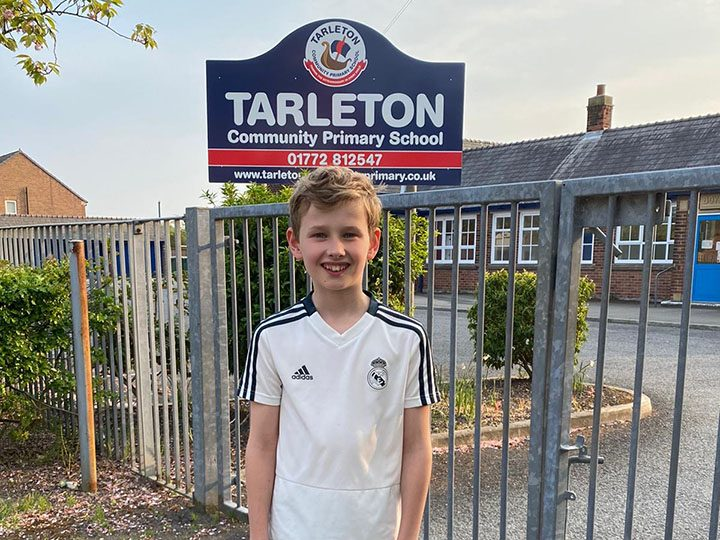 Ollie outside Tarleton Community Primary School