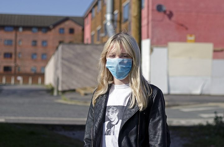 A woman in Preston wears a face mask Pic: Joseph Gudgeon