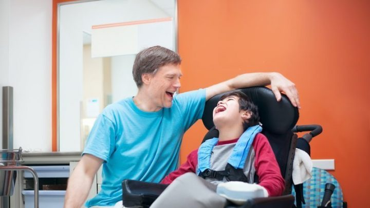 An adult carer with a child with a disability Pic: Skiggle