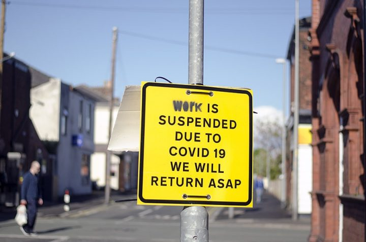 A sign stating coronavirus had suspended work Pic: Joseph Gudgeon