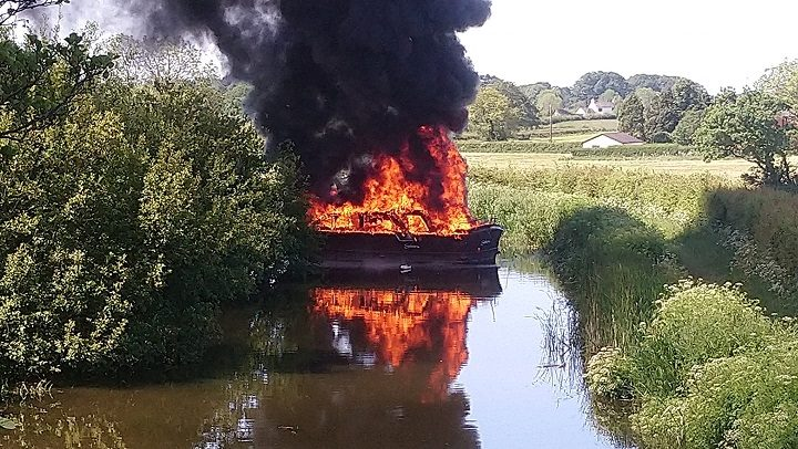 The barge on fire on the Lancaster Canal Pic: Kev Gunn/Lancaster Canal Users Group