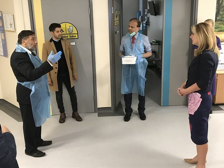 Yousuf Bhailok, far left, handing over some of the testing kits Pic: Lancashire Teaching Hospitals