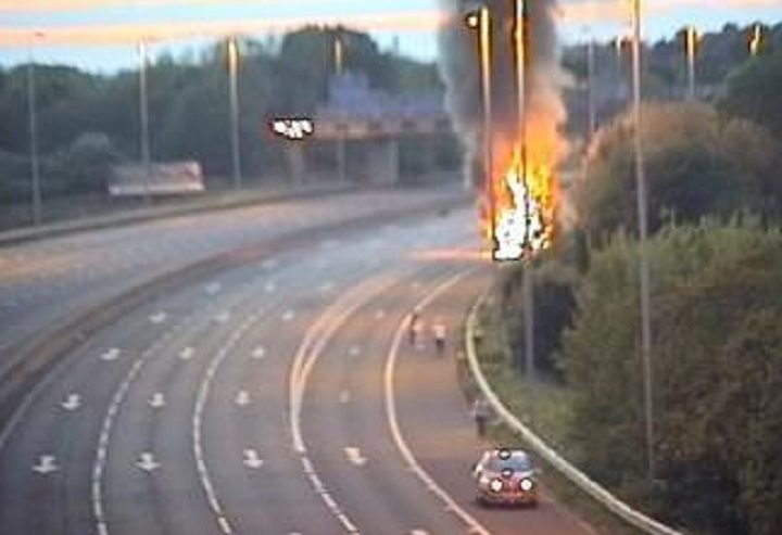 The lorry could be seen burning on the hard shoulder of the motorway Pic: Highways England