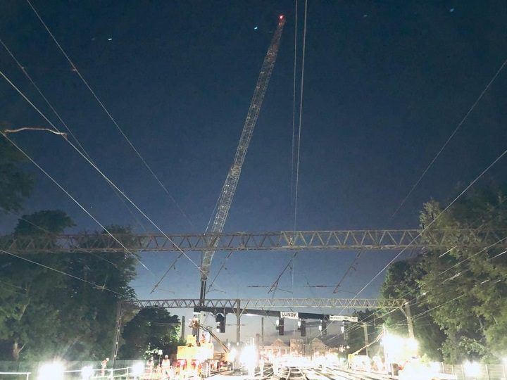 A crane helps move the new gantry into place Pic: Network Rail