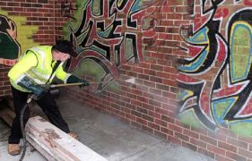 A city council worker removes graffiti from one of the sites in the city targeted Pic: Preston City Council