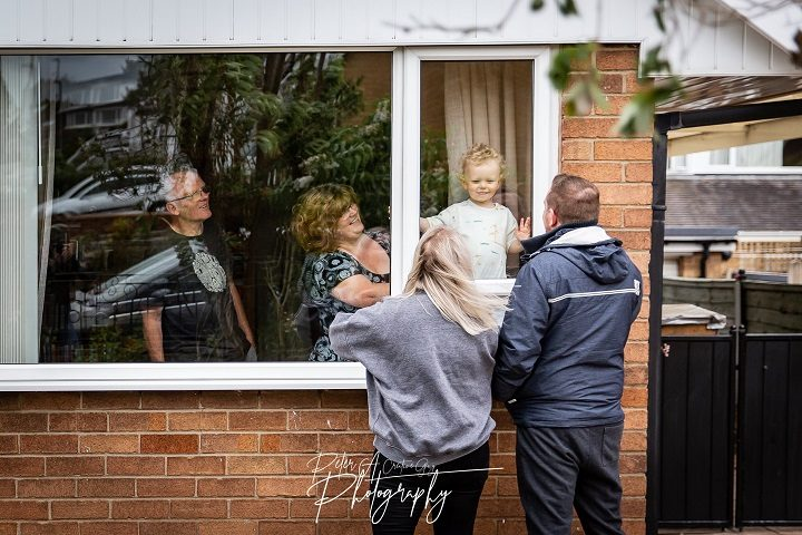 Charlotte and Daniel stand by the window and say hello to their son George Pic: Peter Austin