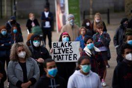 Placards were held aloft during the Black Lives Matter protest in Preston during Wednesday evening Pic: Garry Cook