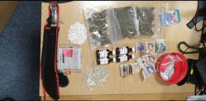 A machete, bindles of cash and Class A, B and C drugs were taken off the streets of Deepdale
