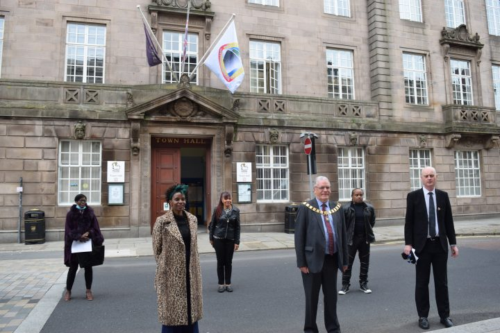 windrush flag raising ceremony at preston town hall