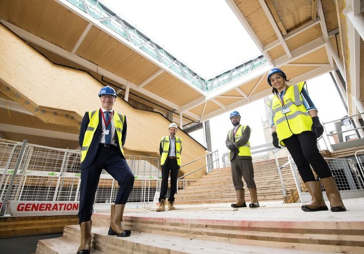 Graham Baldwin, Neil Brook, Michael Ahern and Suntosh Kaur celebrating the topping out of the Student Centre