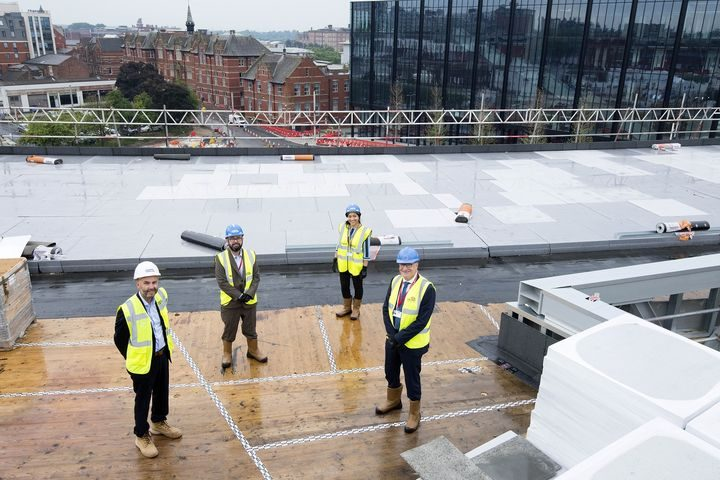 L-R Michael Conlon, Michael Ahern, Sana Iqbal, Professor Mike Thomas, David Taylor and Dave Smith on top of the Student Centre