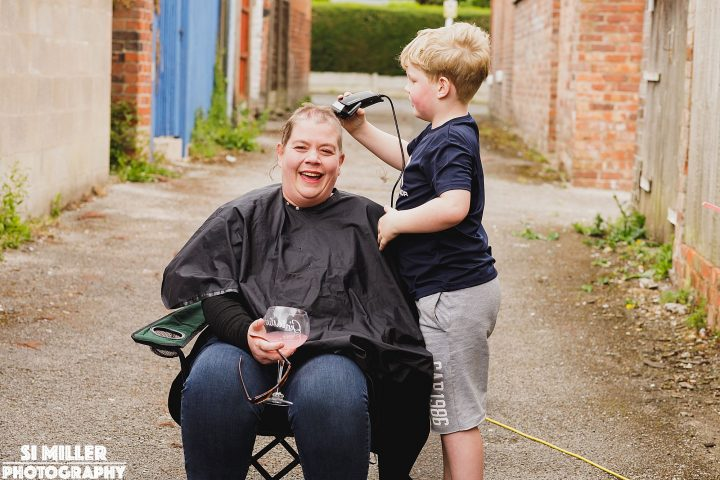 Joel shaving his mum's head Pic: Si Miller
