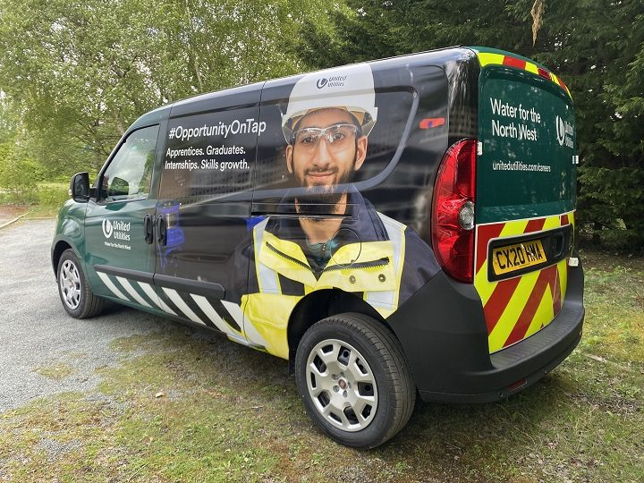 Muhammad Umerji, from Frenchwood, on the side of one of the vans