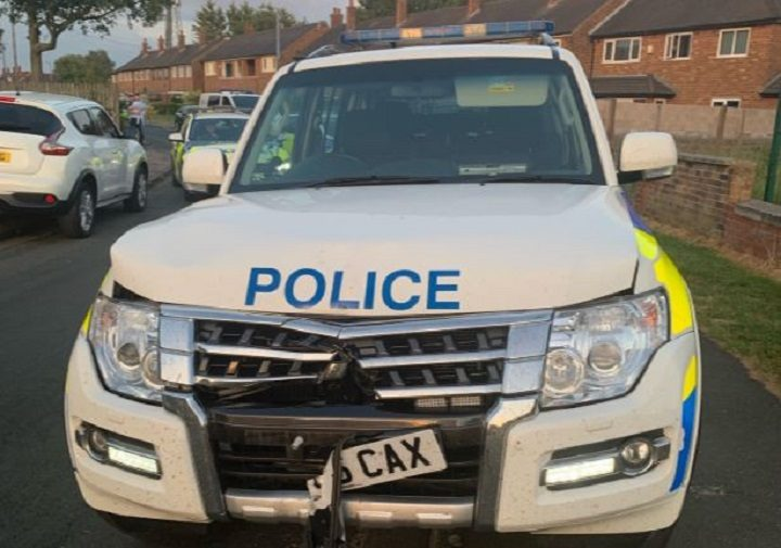Police car left damaged after being rammed by van driver Pic: LancsTacOps