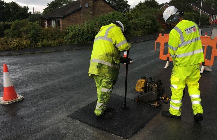 Lancashire County Council's pot hole repair team at work.
