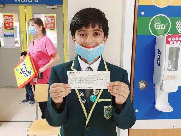 Ahaan Ram with his donation to Royal Preston Hospital
