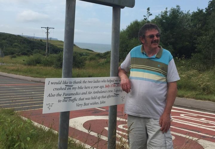 John next to the sign where he crashed