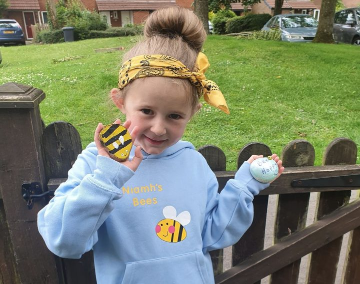 Niamh showing off some of her hand painted bees.