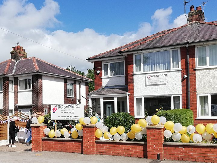 Norma's house decorated with balloon and banners for the summer fete
