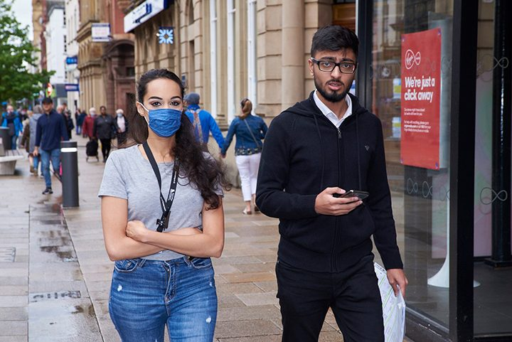 People wearing masks in Preston Pic: Garry Cook