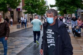 Person wearing a mask in Preston Pic: Garry Cook