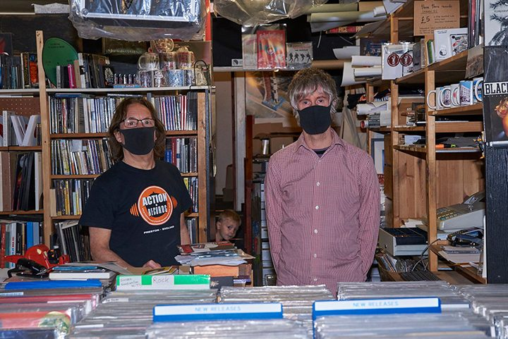 Shop workers wearing masks in Preston Pic: Garry Cook