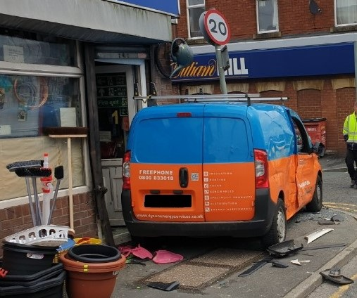 The stationary Peugeot collided with a store front