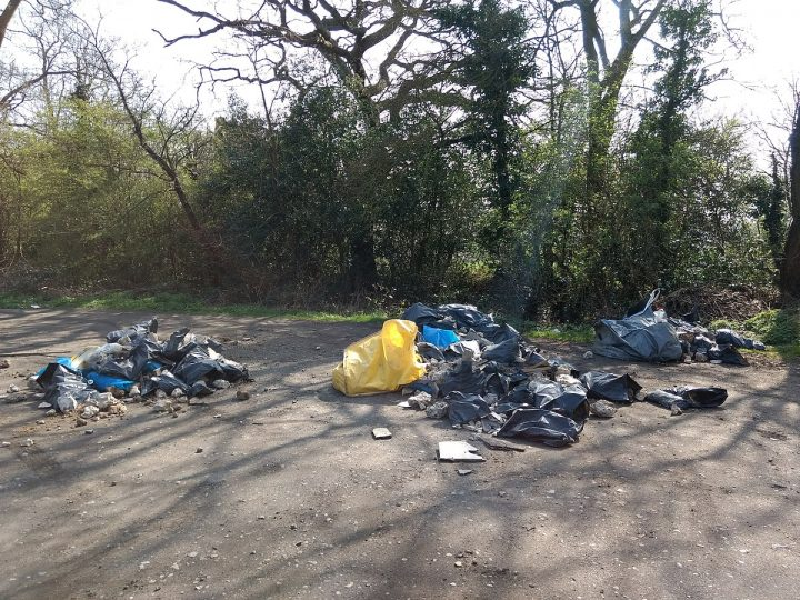 Rubbish strewn across the ground by fly tippers