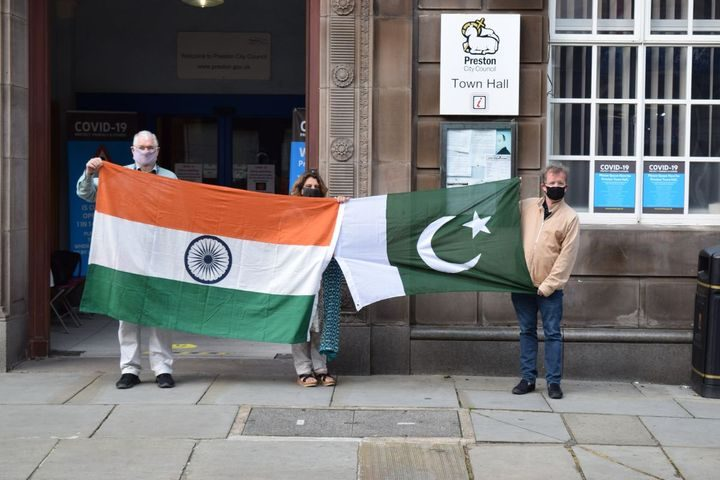 Cllrs Boswell Khan and Kelly with the Indian and Pakistani flags