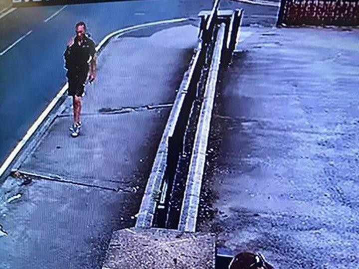 CCTV of male one walking on the pavement outside Guru Nanak Gurdwara