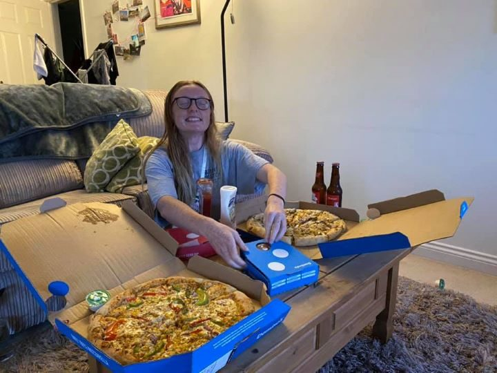 Katrina with her Domino's after finishing her final run on Thursday