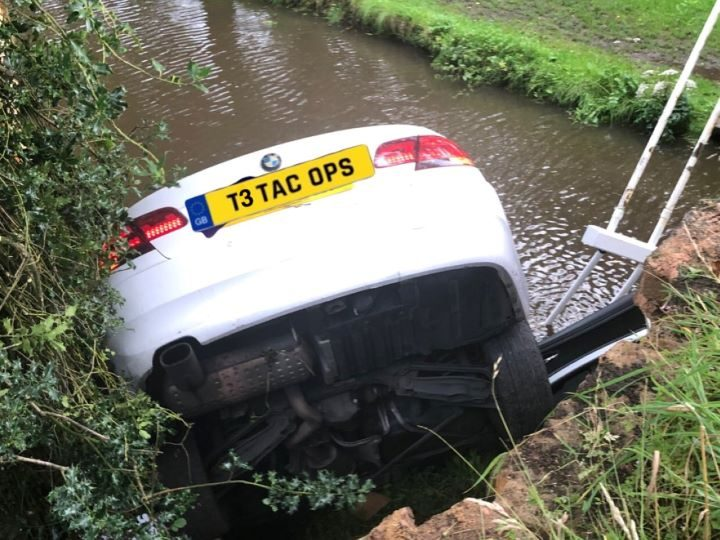 White BMW in the Forton canal