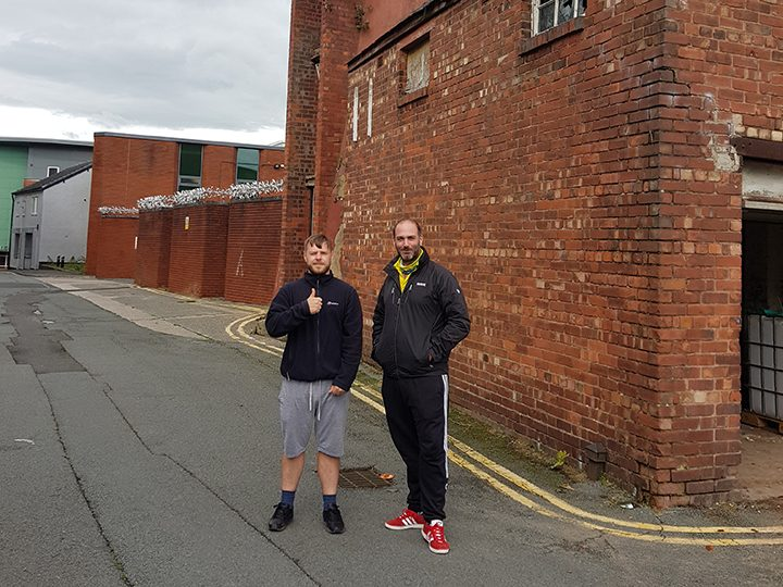 Chris for Preston Here for Humanity (left) and Craggs Mill owner Richard outside the building