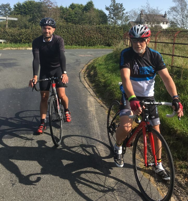 Colin with son Chris, who accompanied him on his three hills for three charities challenge