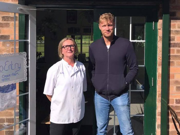 Freddie posed for a photo with cafe owner Kelly