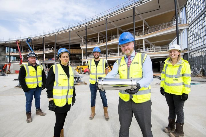 L-R Ian Roberts, Shaheen Gul, Bob Turner, Aidan Nelson and Phoebe Dennis outside the new Student Centre with the time capsule