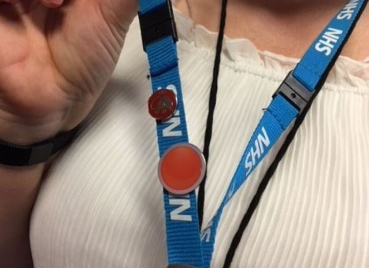 The orange button is worn by people with suicide prevention training