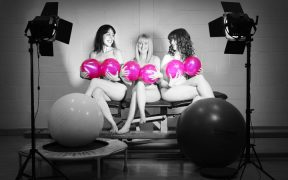 Physios posing for the charity calendar
