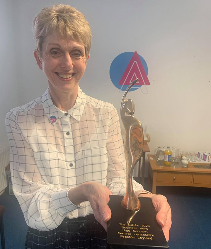 CEO Suzanne Carr with the award