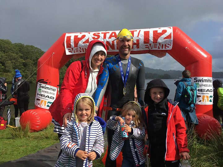 Bob with his family after an open water swimming challenge