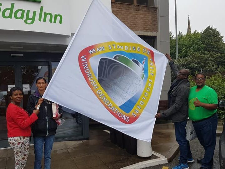 Glenda and Sekeena pictured left with the new flag for Windrush Pic: PWGD UK
