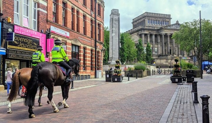 Police officers on horseback make their way through Preston city centre Pic: Tony Worrall