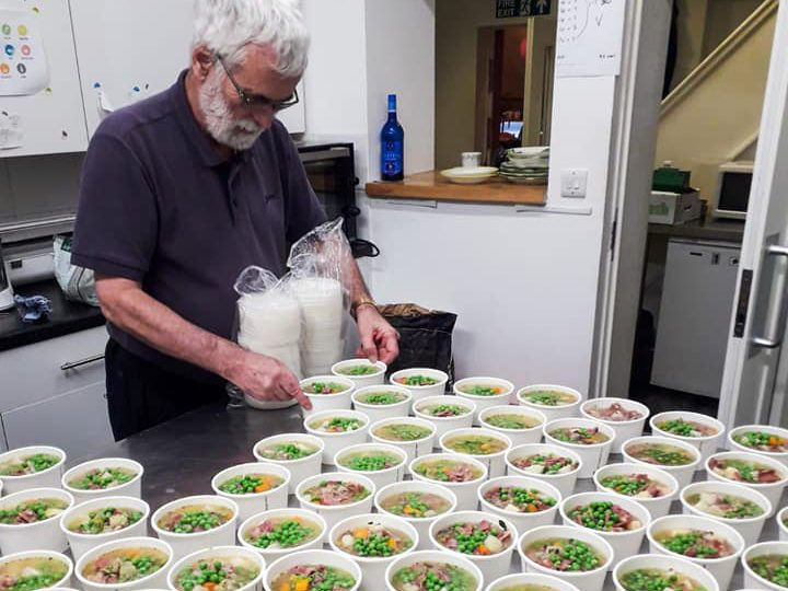 A volunteer at The Larder prepping meals