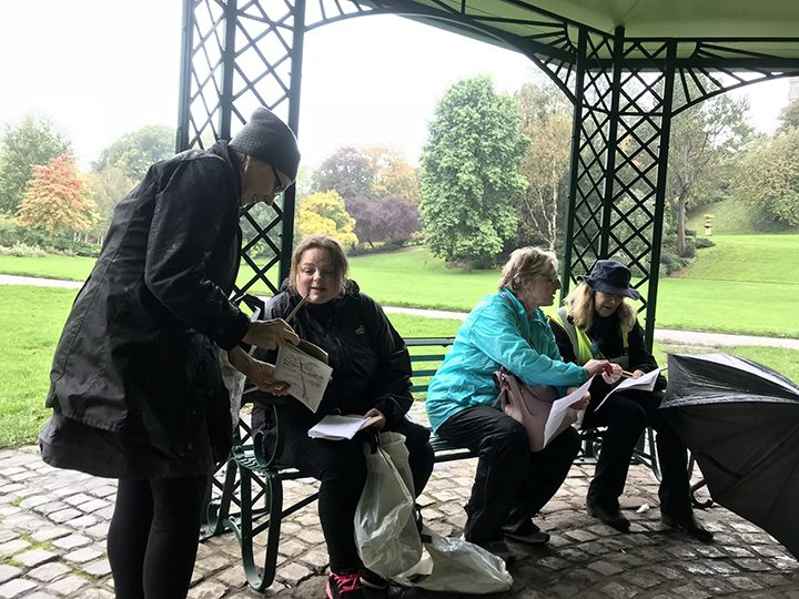Walk participants working together to make collaborative haiku poems in Miller Park October 2019 Photo courtesy of Fiona Candy