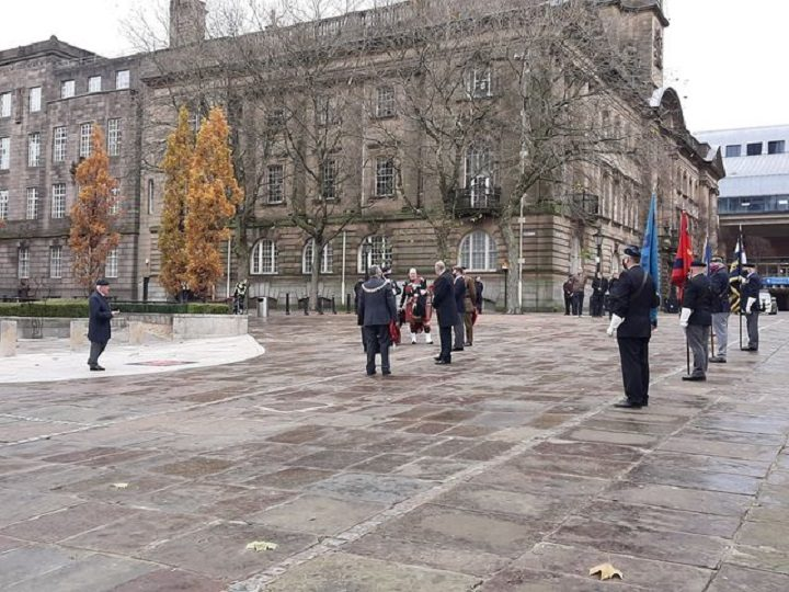 The Sunday service on the Cenotaph - with just a handful of people spread across the Flag Market Pic: Rebecca Thompson