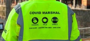 The back of a Covid marshal's jacket