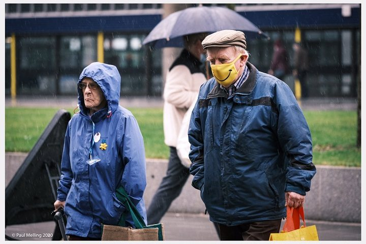 Walking through Preston with a smiley face mask Pic: Paul Melling