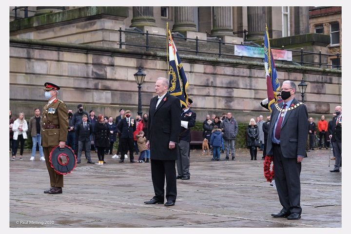 A scaled-back remembrance service on the Flag Market, led by the chief executive of Preston City Council Pic: Paul Melling
