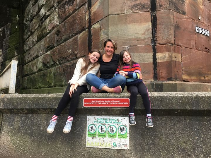 Isobel (11), Louise and eight-year-old Heidi at the plaque which marks the start of a scenic 2.5k stretch of the Guild Way that is dedicated to Ben