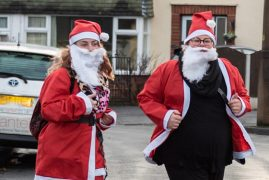 Fulwood shop manager for St Catherine's Hospice, Heather Crabtree, right, on the Santa Dash Pic: David Duxbury